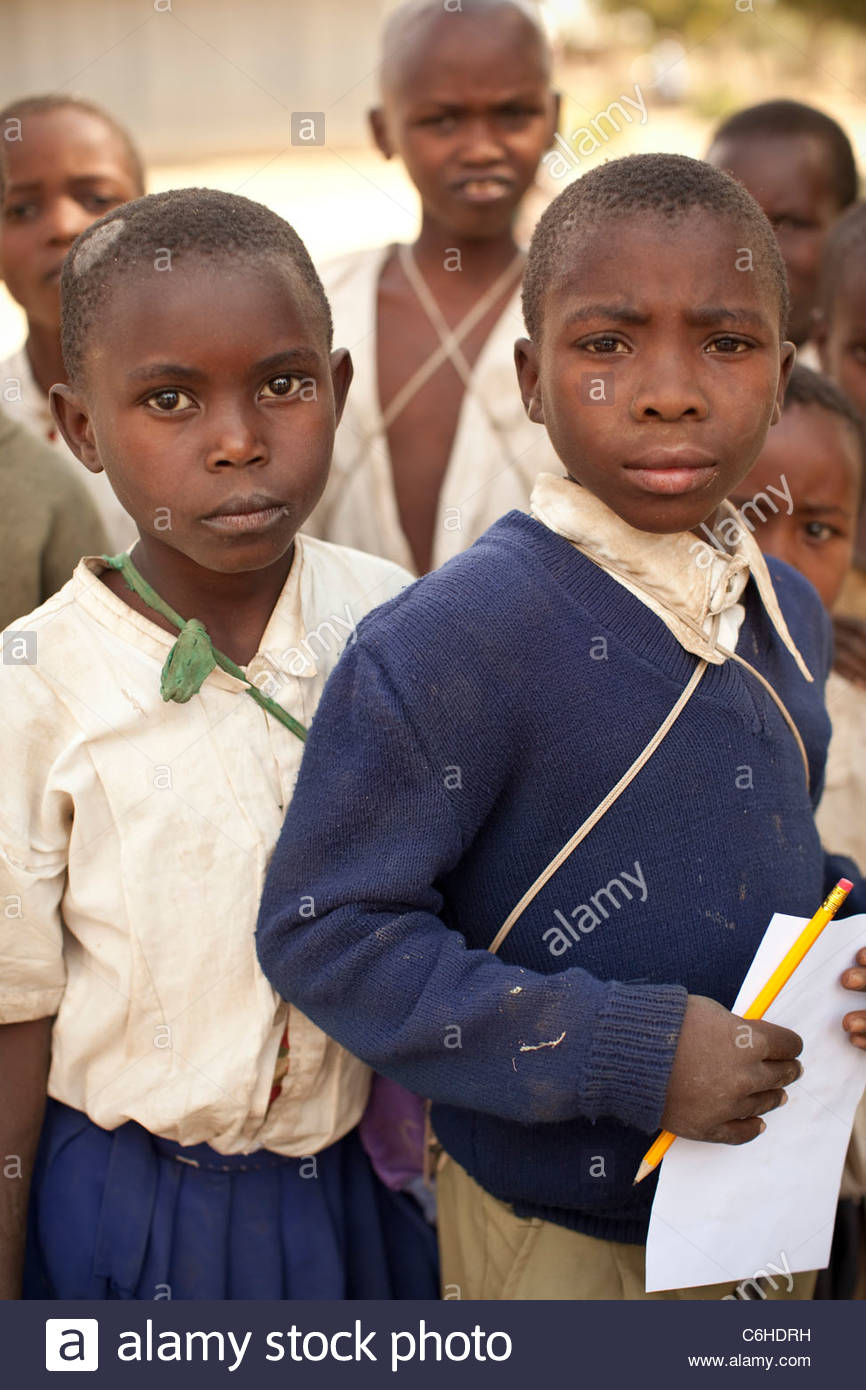 Young primary school children in school uniform - Stock Image