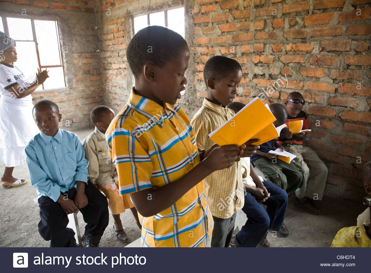 Young boys smartly dressed and singing at a church service - Stock Image