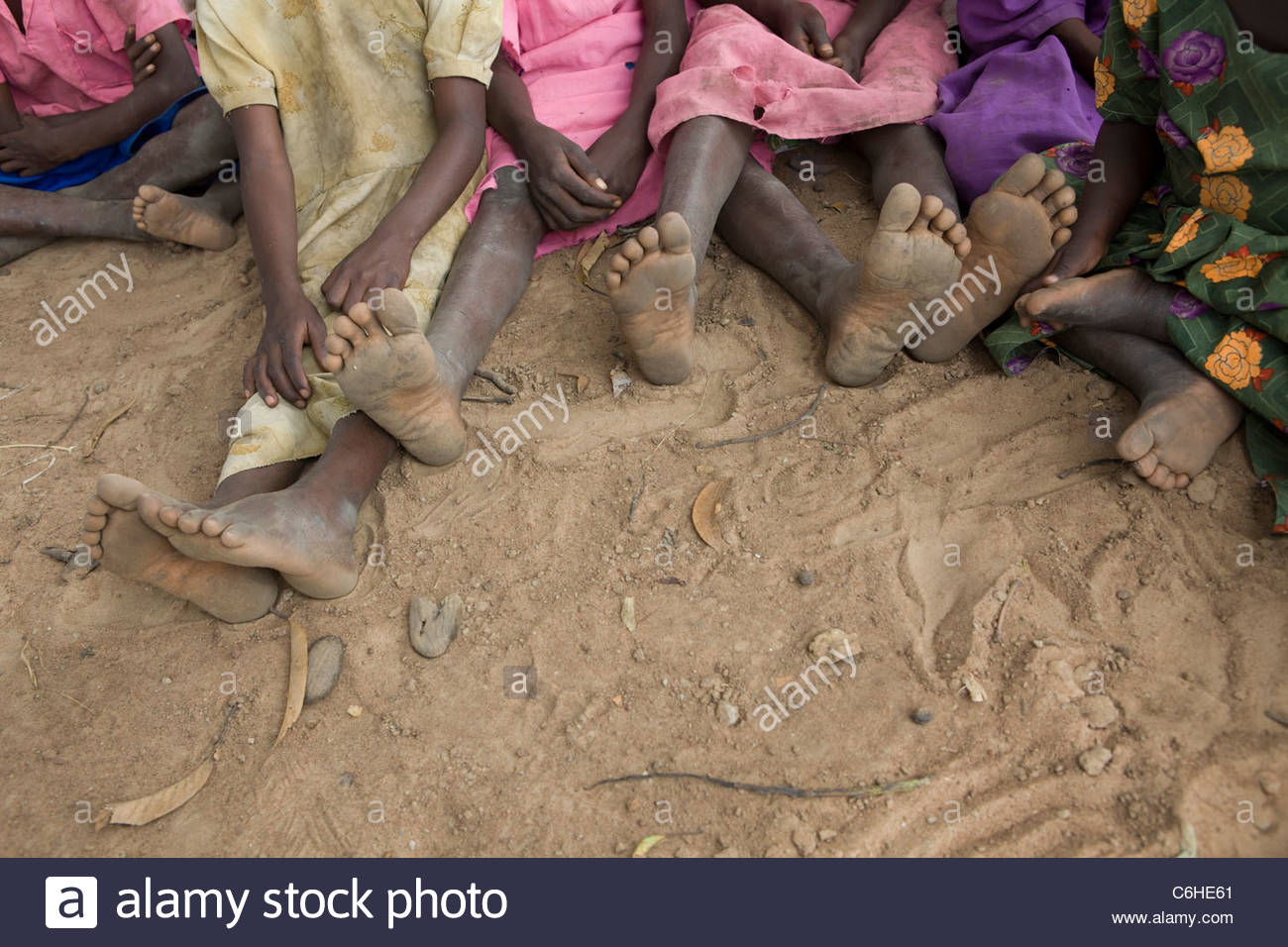 Children's bare feet at a refugee camp - Stock Image