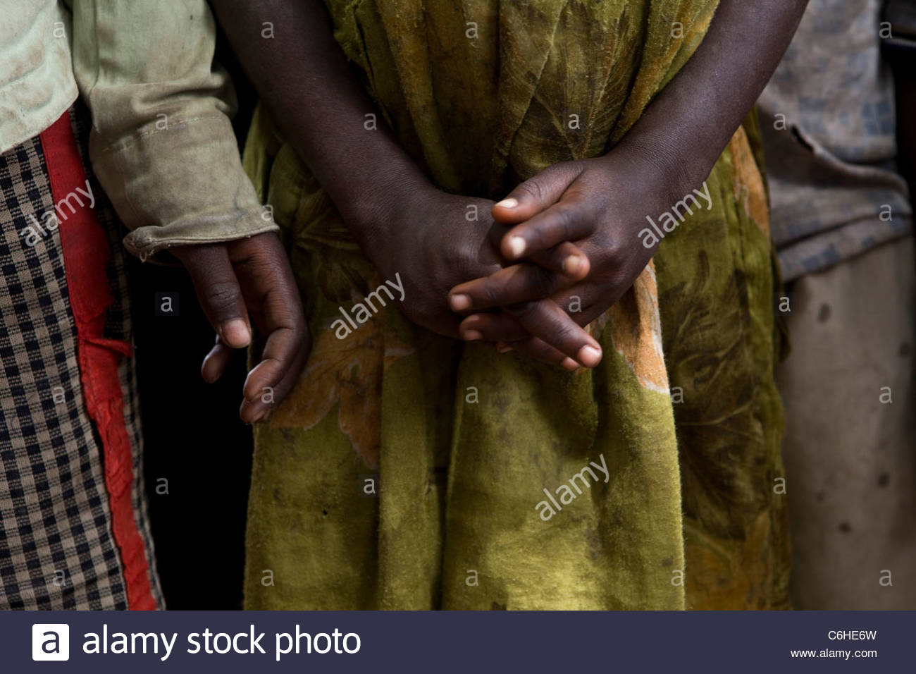 Child's hands in a refugee camp - Stock Image