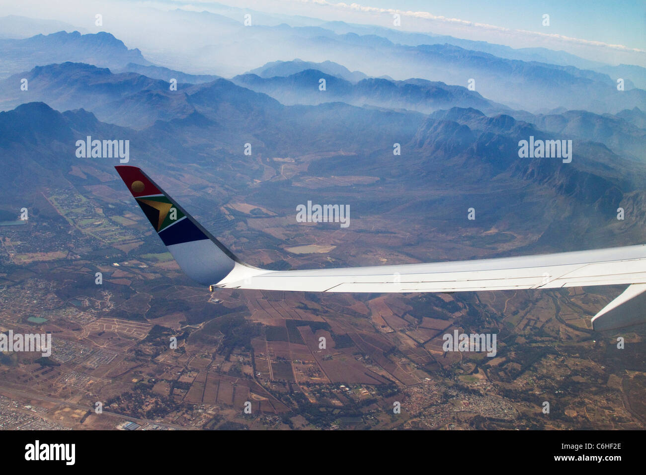 The wing tip of a SAA jet viewed against the Cape Fold mountains near Cape Town - Stock Image