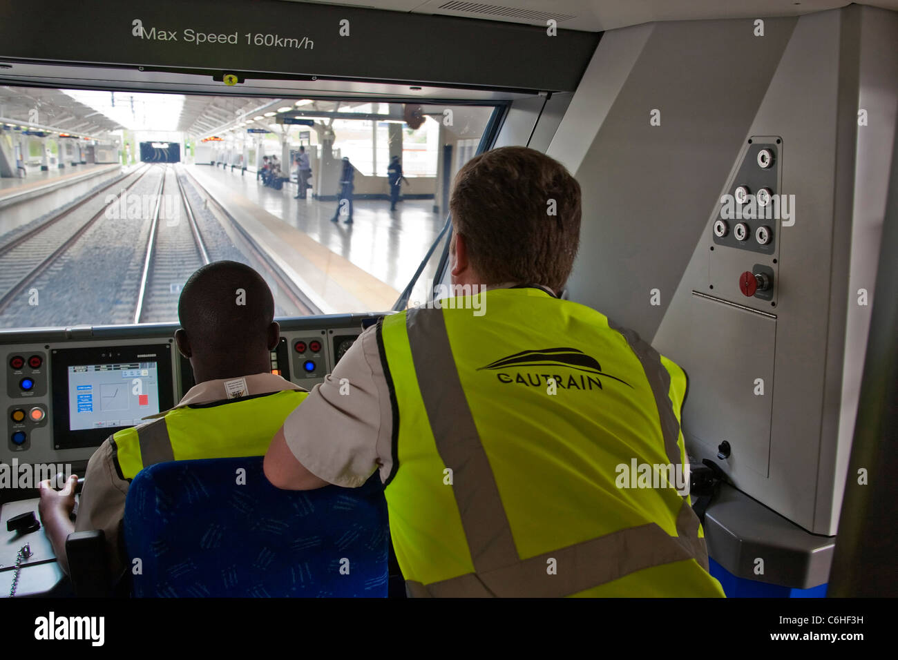 View through the cockpit of the Gautrain entering a station with a trainee driver during training - Stock Image