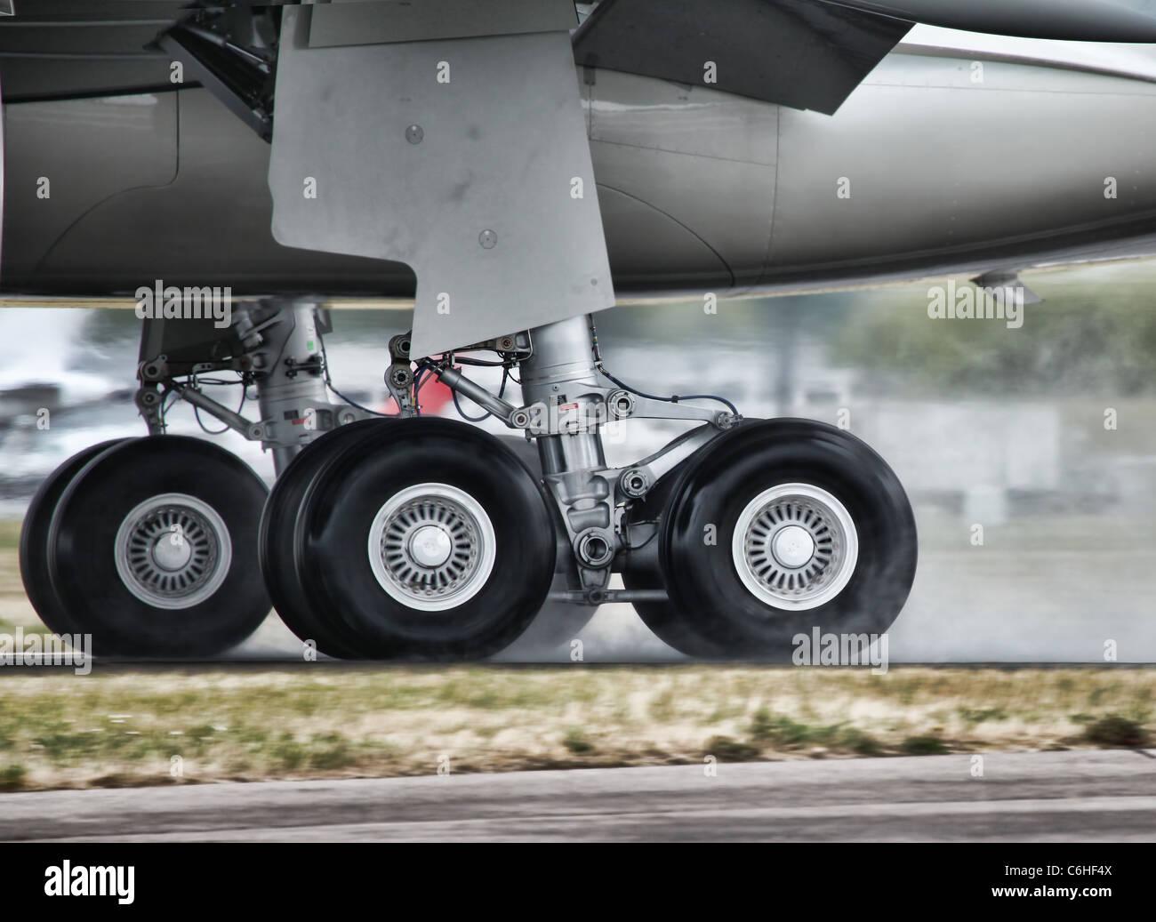 Aircraft Landing on a Wet Runway - Stock Image