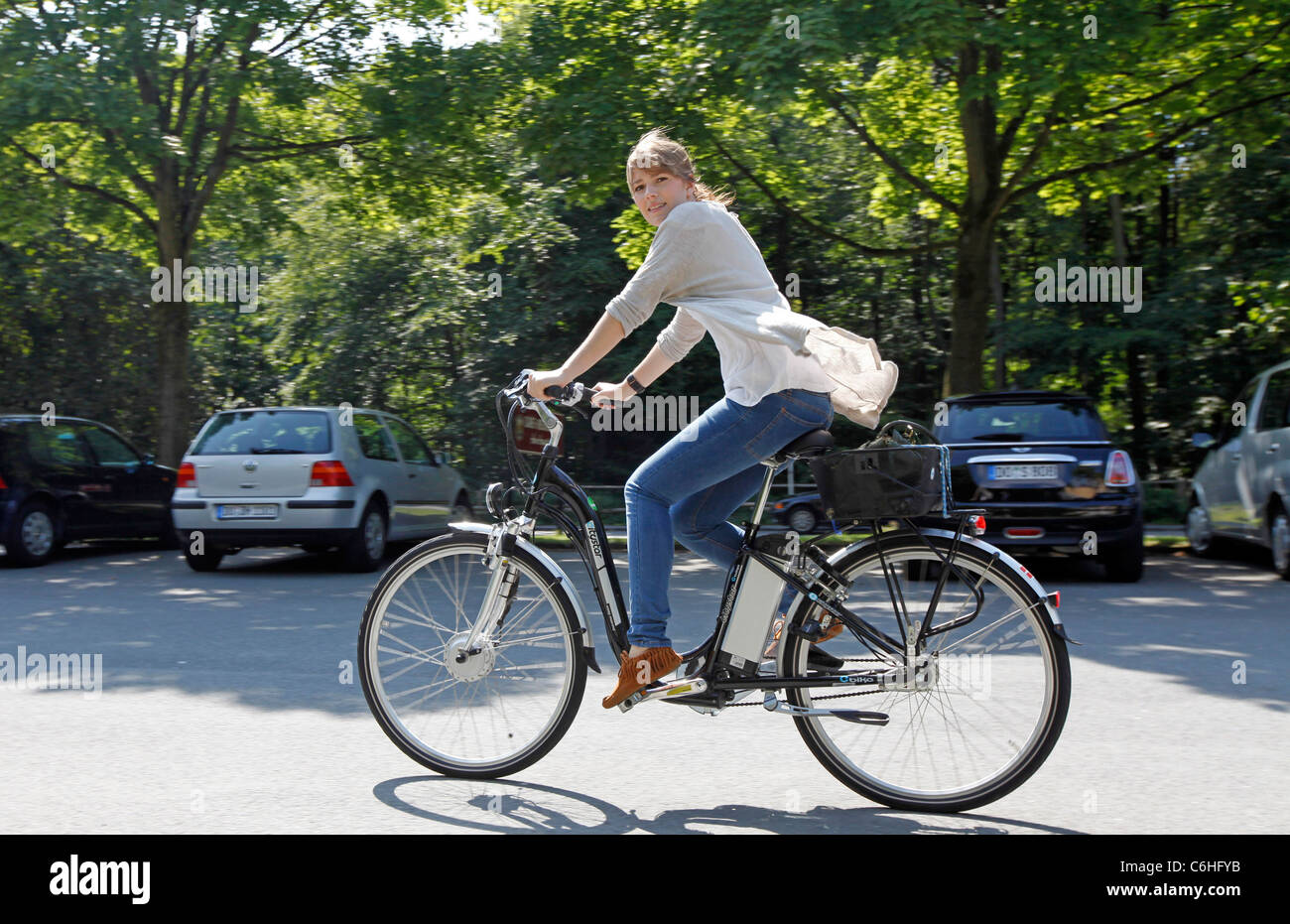 Girl riding on electric bicycle, pedelec, ebike, e-bike, Dortmund, Germany Stock Photo