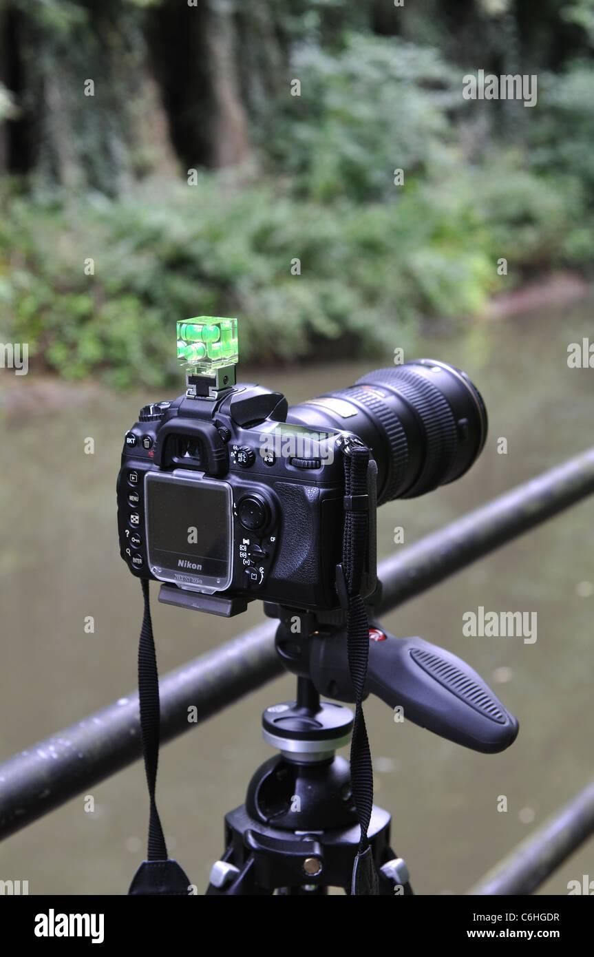 Nikon DSLR camera on a tripod - Stock Image