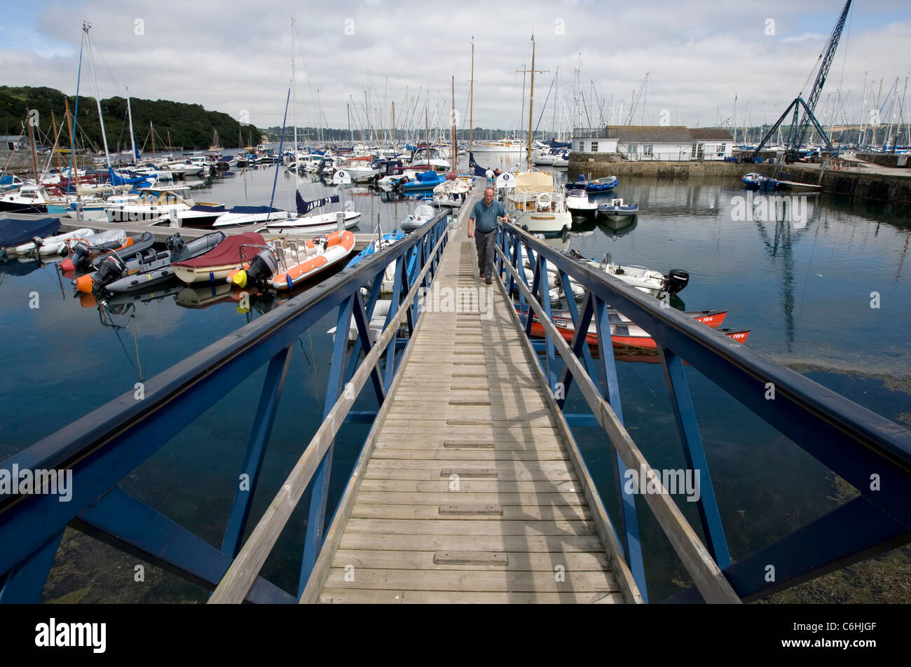 Pontoon bridge leading down to the moored boats at Mylor yacht harbour - Stock Image