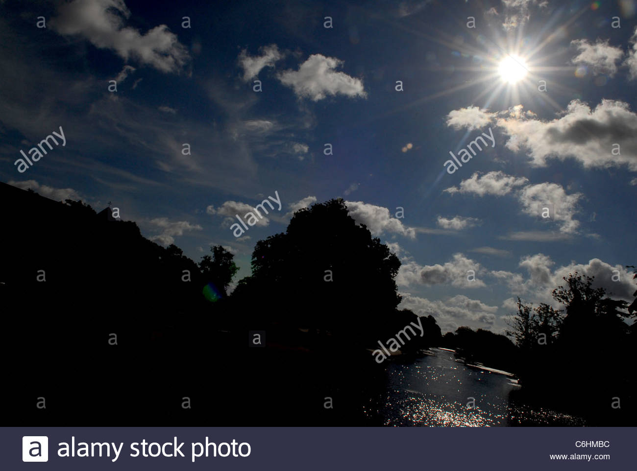 Sun and fluffy clouds over the river in Bedford - Stock Image
