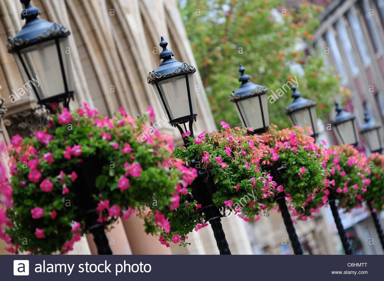 Hanging Baskets, Street Lamps. - Stock Image