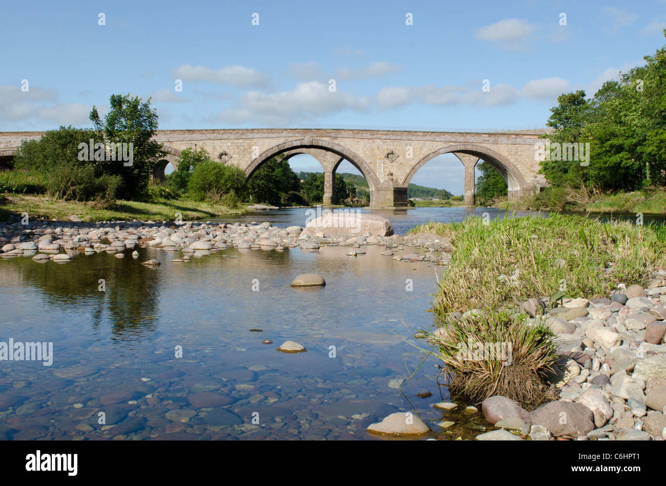 Railway viaduct and road bridge across North River Esk still water at St Cyrus National Nature Reserve - Kincardineshire - Stock Image