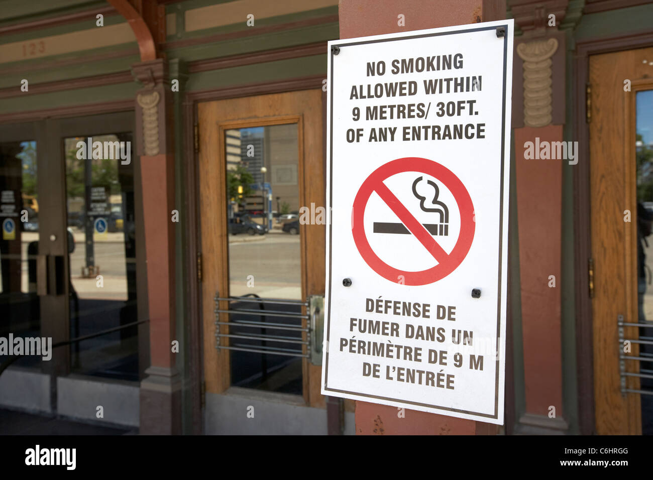 no smoking allowed within 9 metres distance of any entrance on public building winnipeg manitoba canada - Stock Image