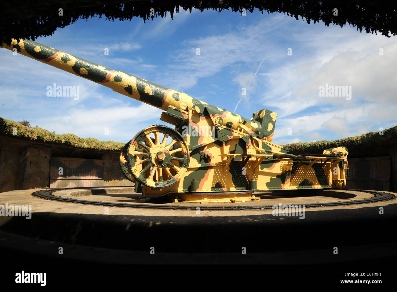 WW11 German 22cm artillery piece on display in a restored bunker at Batterie Dollmann, Guernsey. - Stock Image