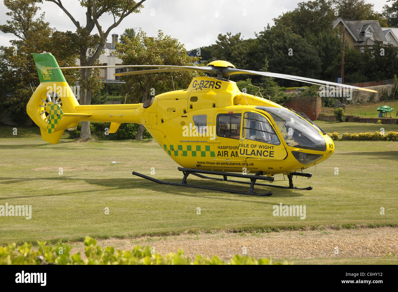 Hampshire & Isle Of Wight Eurocopter EC-135 air ambulance G-BZRS following an operational landing on a lawn. - Stock Image