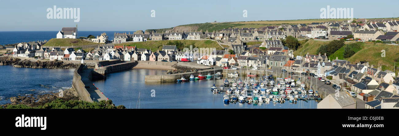 Panoramic view of Findochty Harbour with gable ends and sailing vessels on fine day - Moray Coast - Stock Image