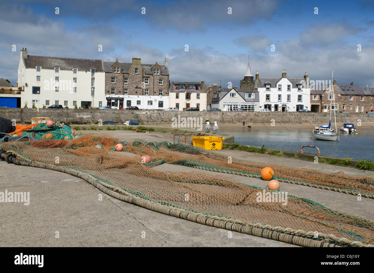 Fishing nets strewn in harbour at Stonehaven - Kincardienshire - Stock Image