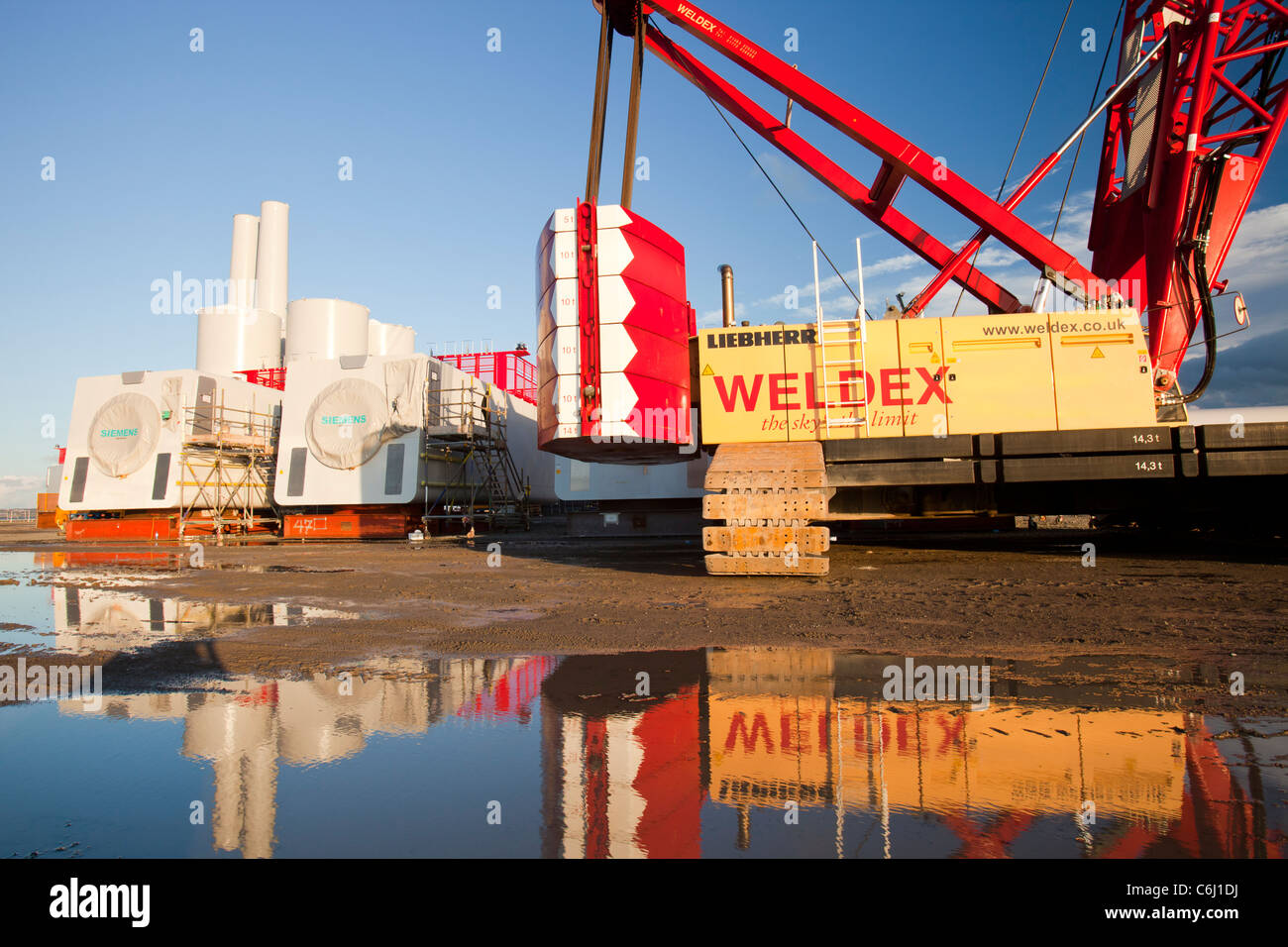 Offshore wind turbine parts on the docks at Mostyn Stock Photo