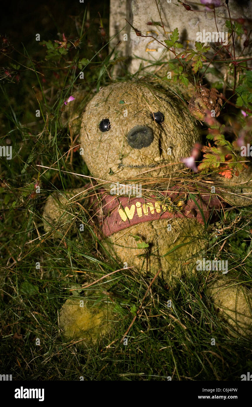 rotting stuffed toy in a children's graveyard - Stock Image