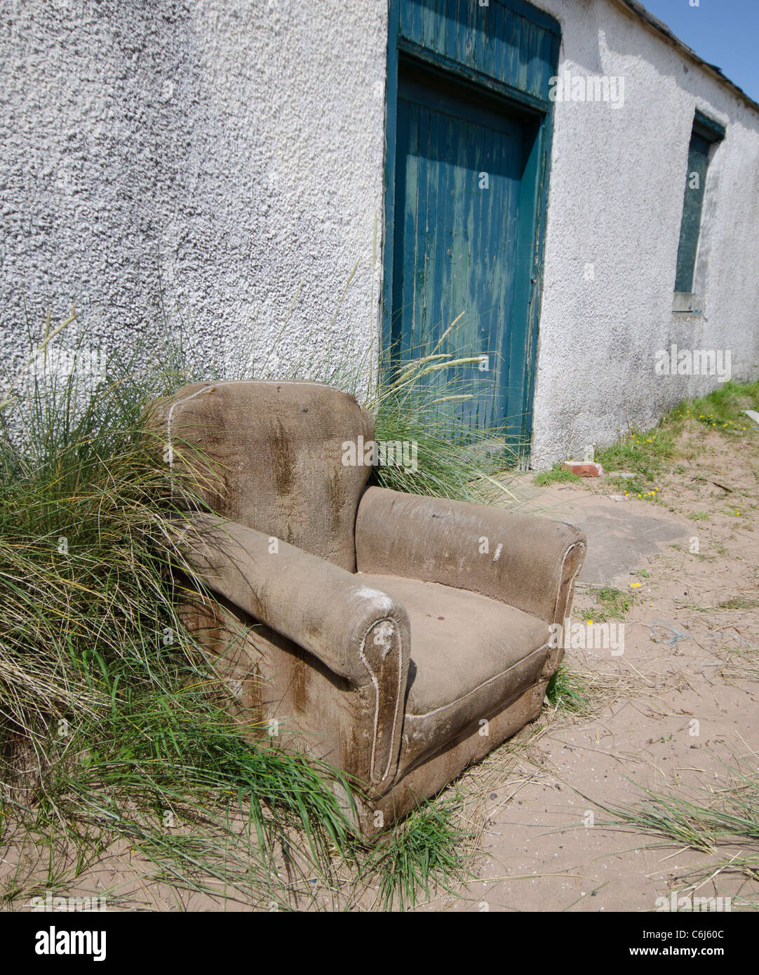 weathered armchair outside bothy at St Cyrus Nature Reserve Kincardineshire - Stock Image
