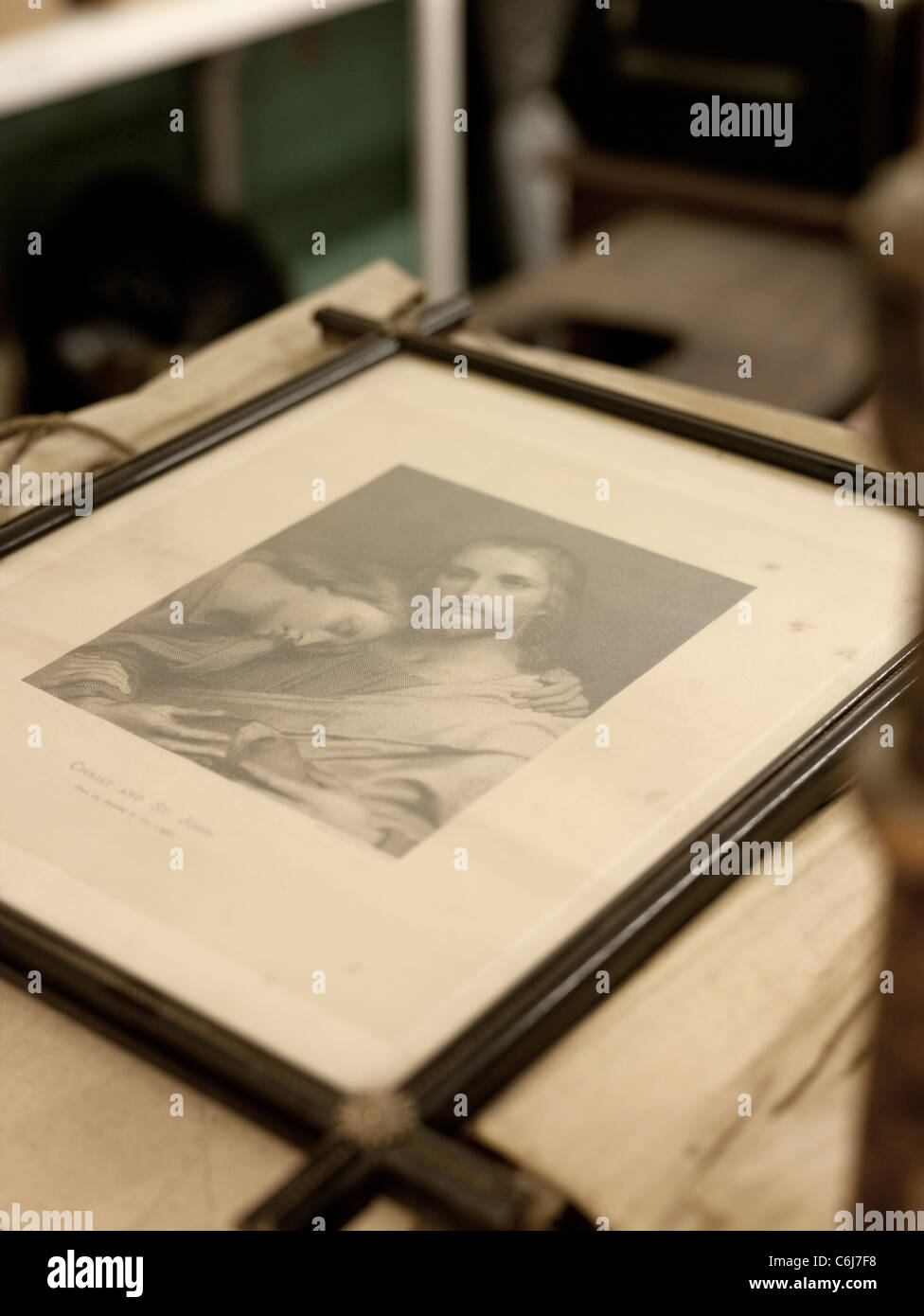 Antique picture of Jesus in an old frame - Stock Image