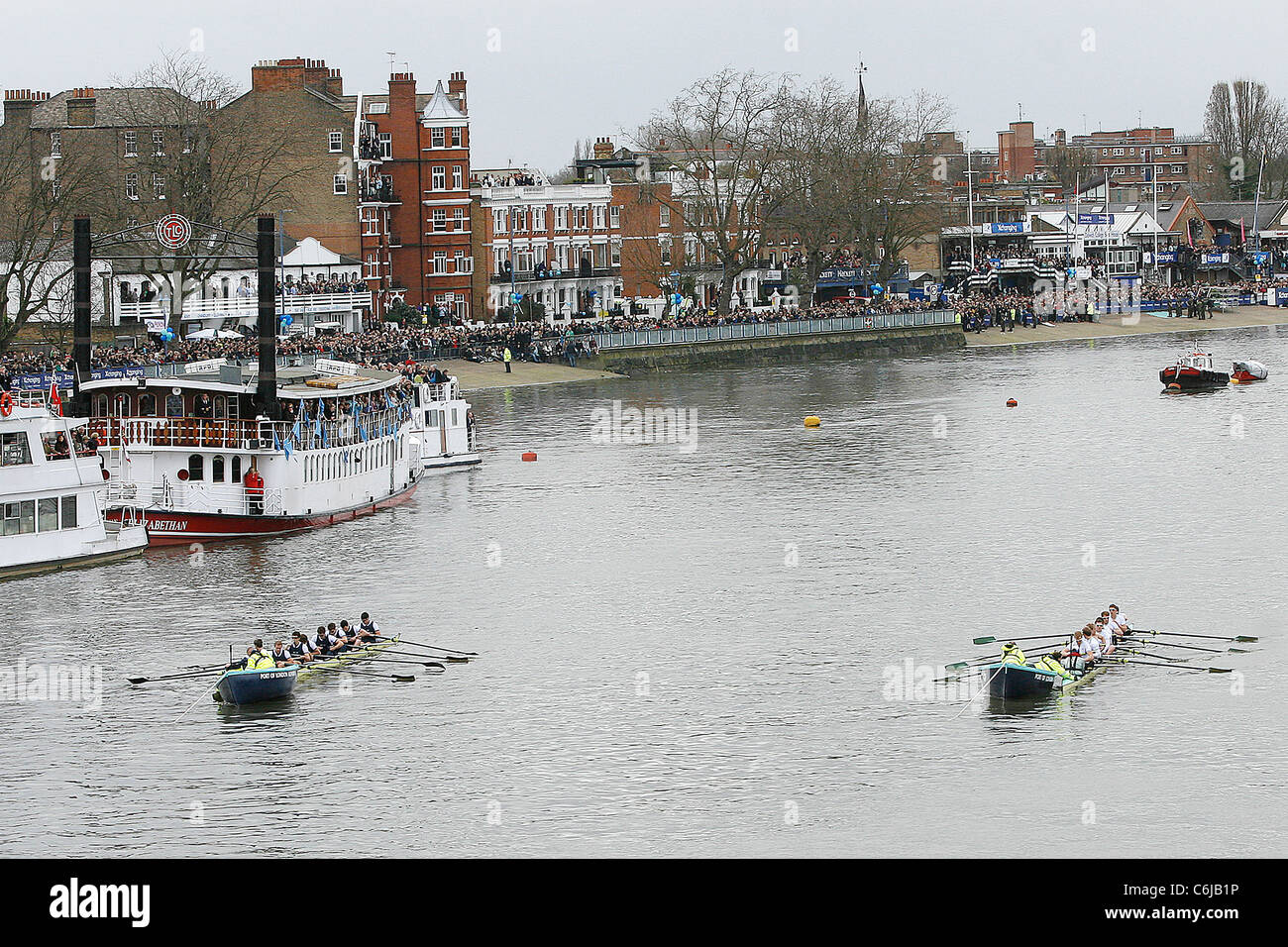 Oxfrod and Cambridge boat teams at the start of the 156th Oxford vs Cambridge boat race on River Thames London, - Stock Image