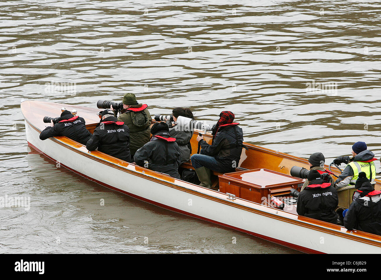 Photographers at the start of the 156th Oxford vs Cambridge boat race on River Thames London, England - 03.04.10 - Stock Image