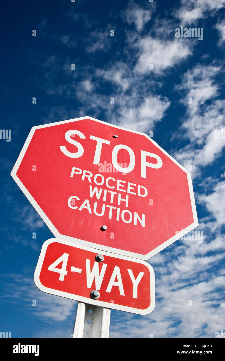 Stop, proceed with caution red road sign in Arizona, USA - Stock Image