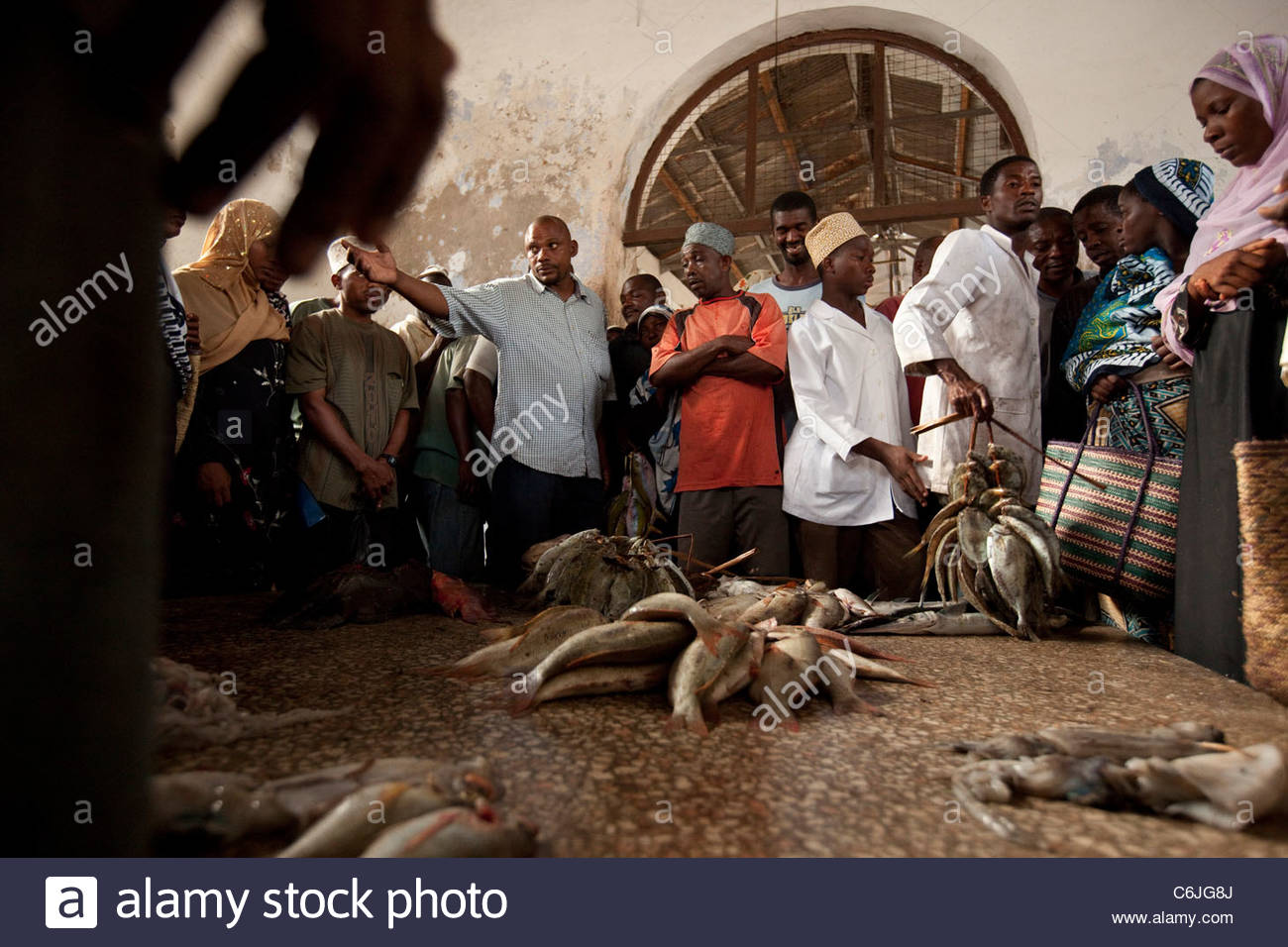 Bundles of fish for sale at the fish auction - Stock Image