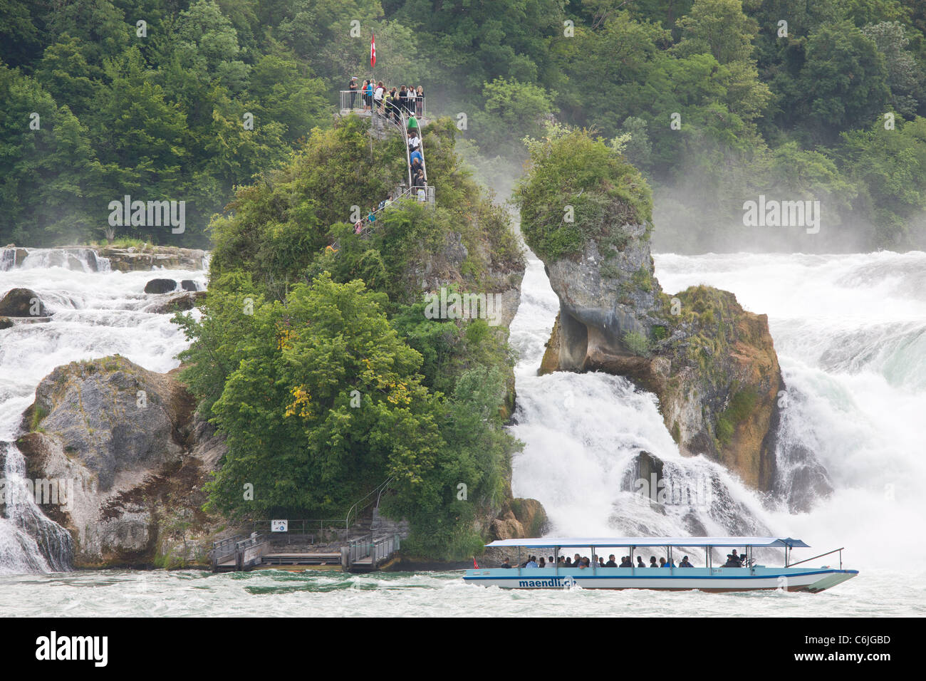 Tourist boat and visitors at Rhine Falls (Rheinfall) at Schaffhausen - largest in Europe - Stock Image