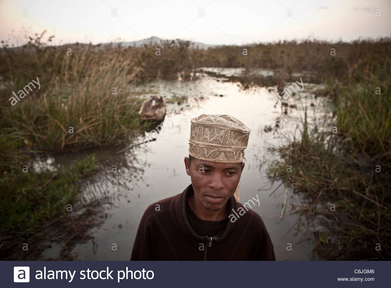 Local man standing on the shore of Lake Babati. - Stock Image