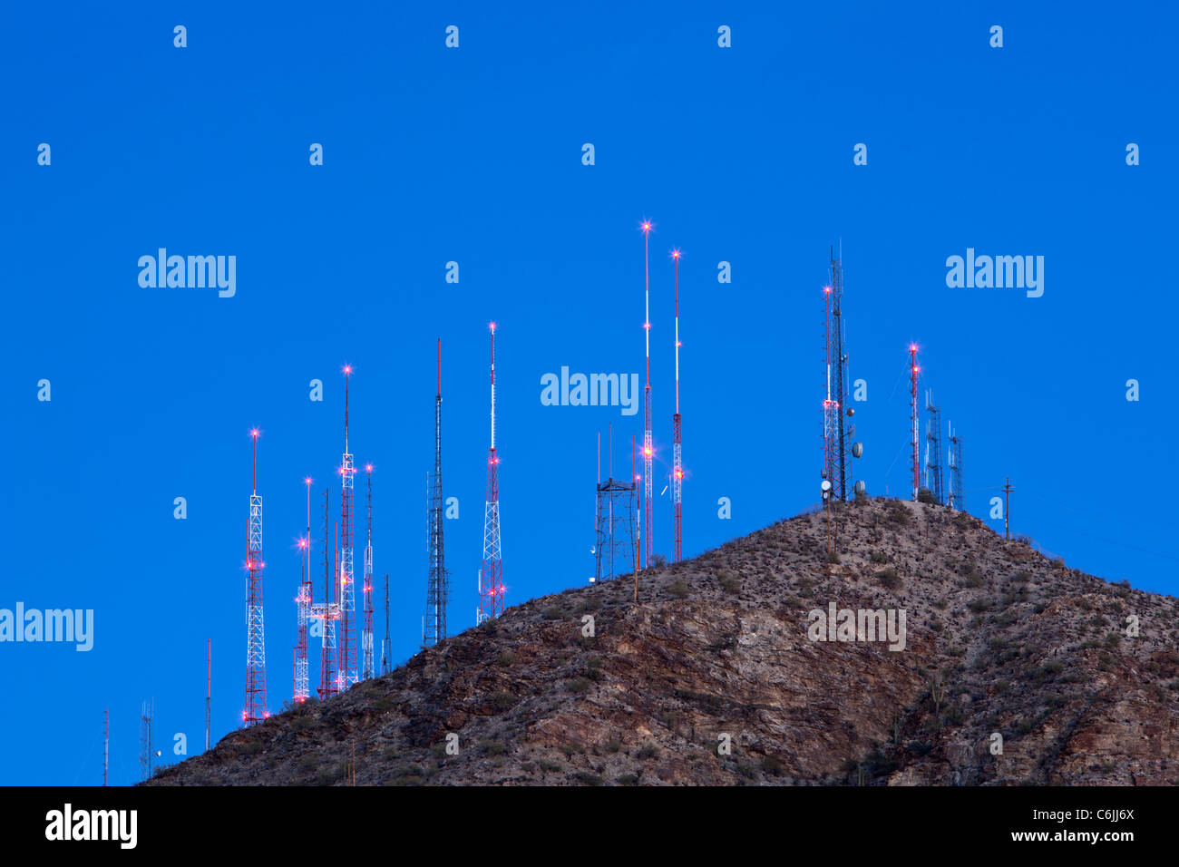 Transmission masts at dusk in Phoenix South Mountain Park, Phoenix, USA - Stock Image