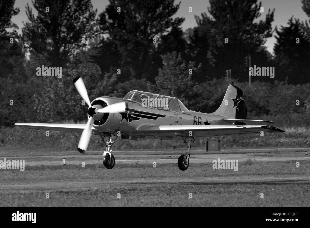 A Yakovlev aerobatic aeroplane landing at Shoreham airfield in 2011 - Stock Image