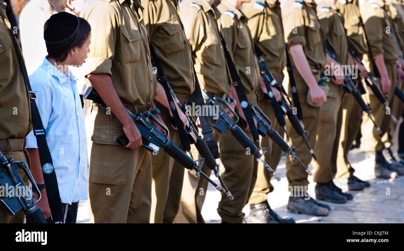 An ultra-orthodox boy stands among participants in the Israeli Army's Marva program, which gives foreign Jews - Stock Image