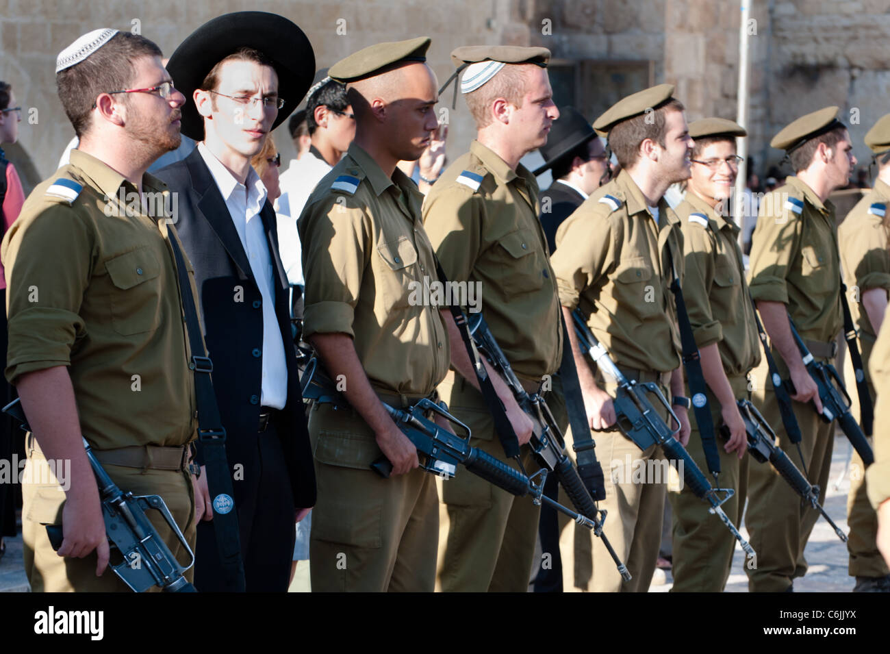 An ultra-orthodox Jew stands among participants in the Israeli Army's Marva program, which gives foreign Jews - Stock Image