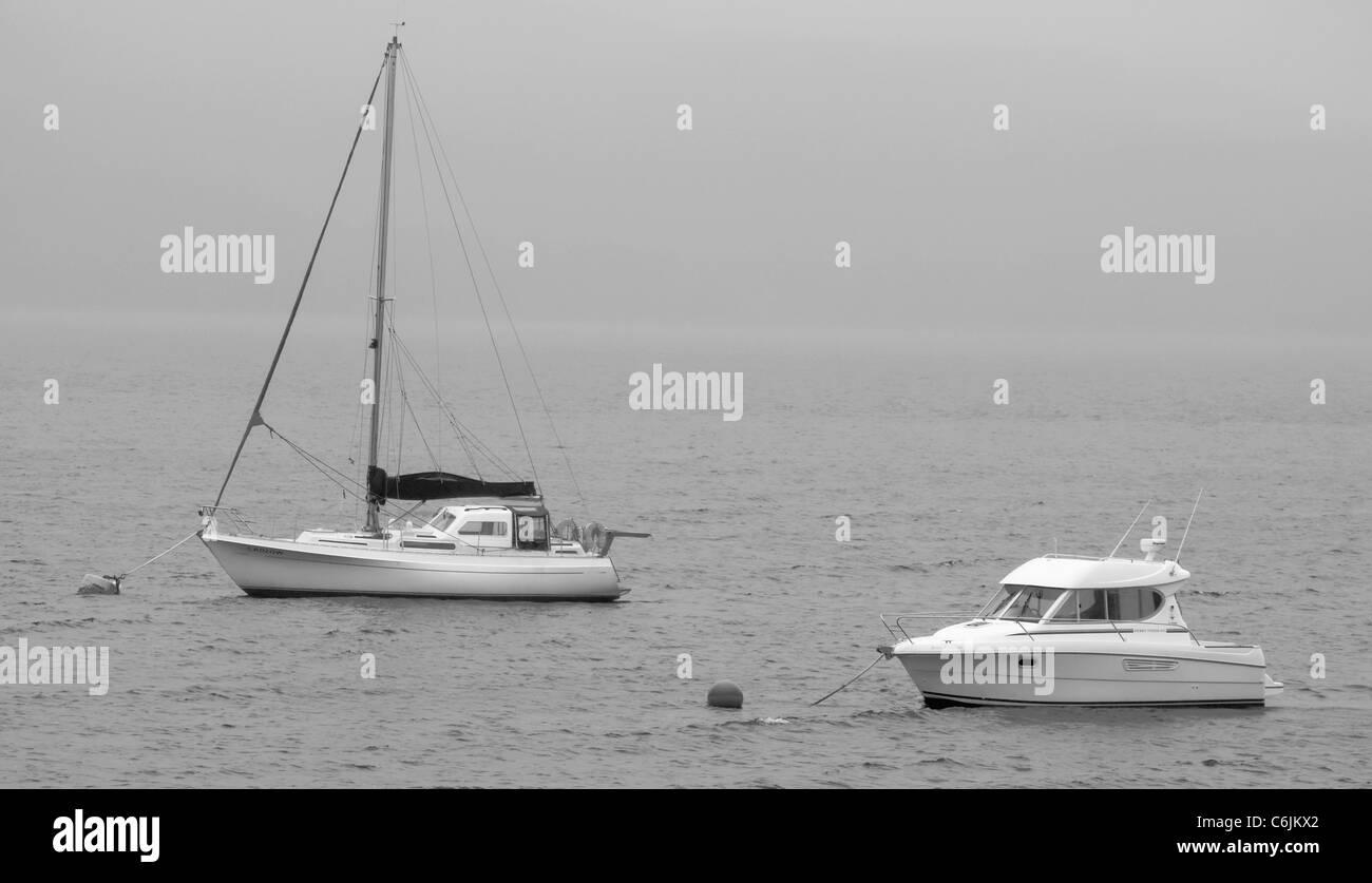 Yachts on a misty loch - Stock Image