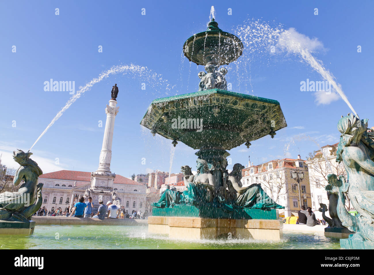 Baroque fountain on rossio square the liveliest placa in Lisbon with wavy cobble stone pattern, Portugal Stock Photo
