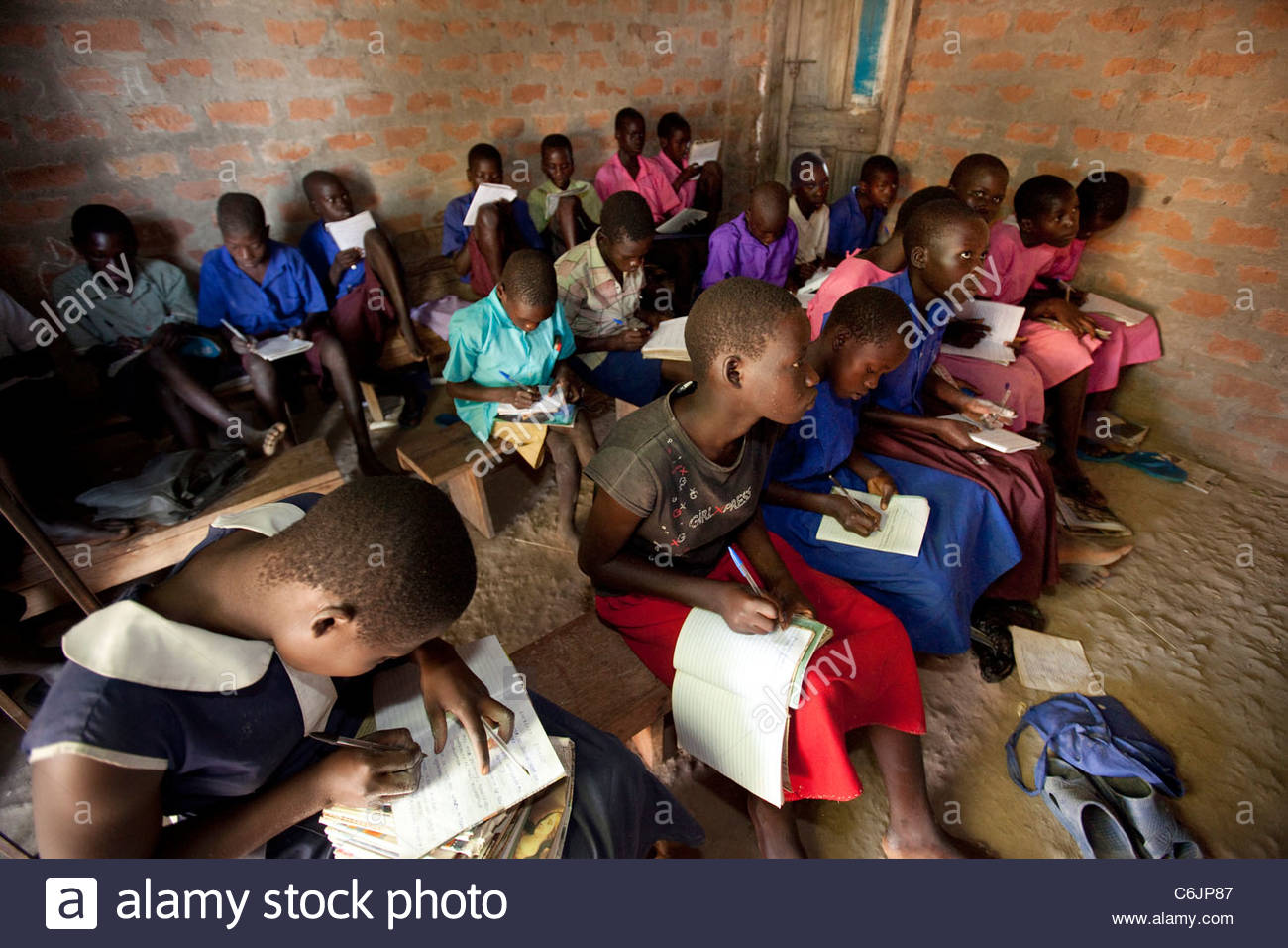 Elementary Classrooms Without Desks ~ Primary school children learning in a dark classroom