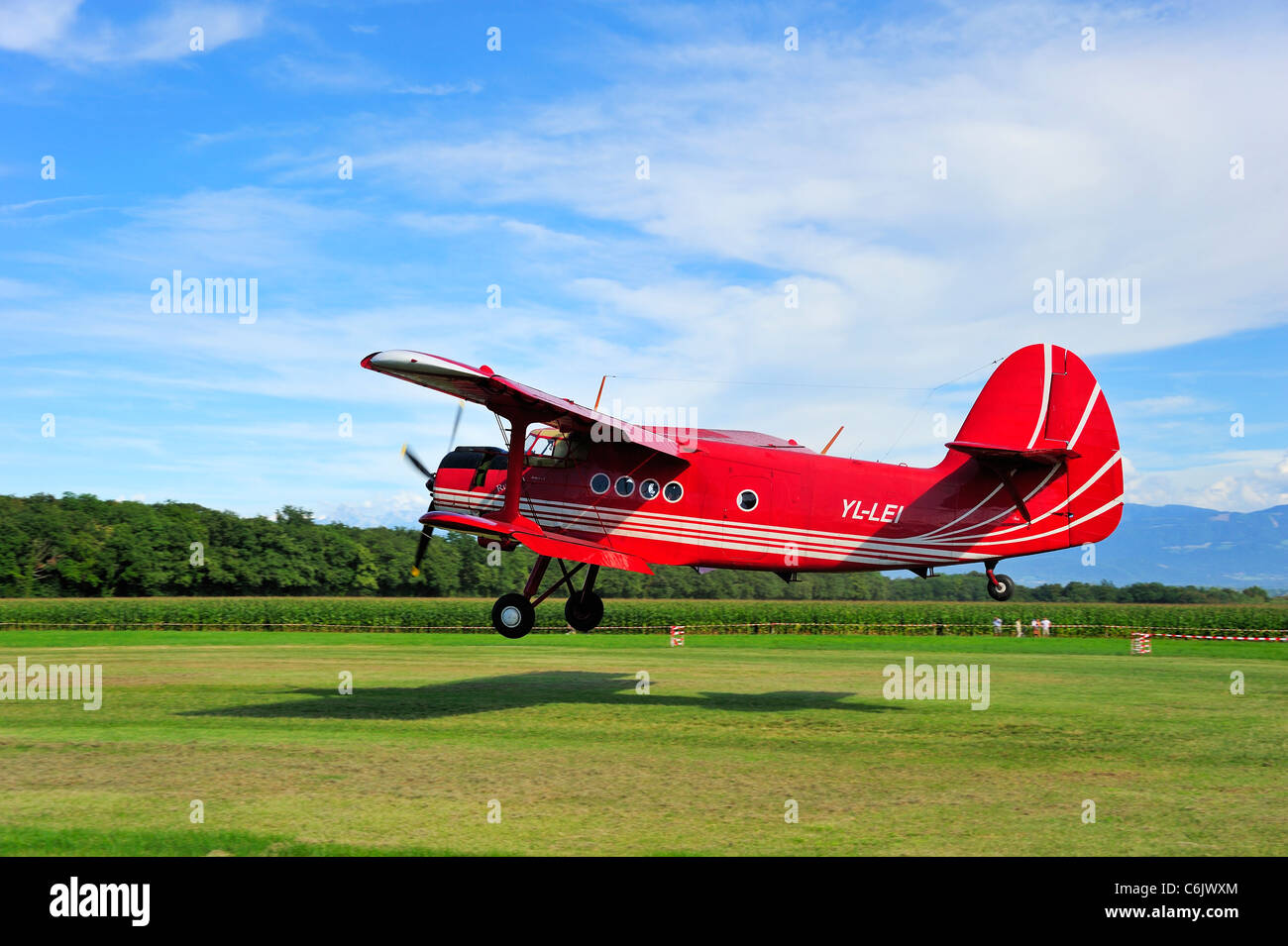 An Antonov AN-2 biplane landing. Motion blur on the background. - Stock Image