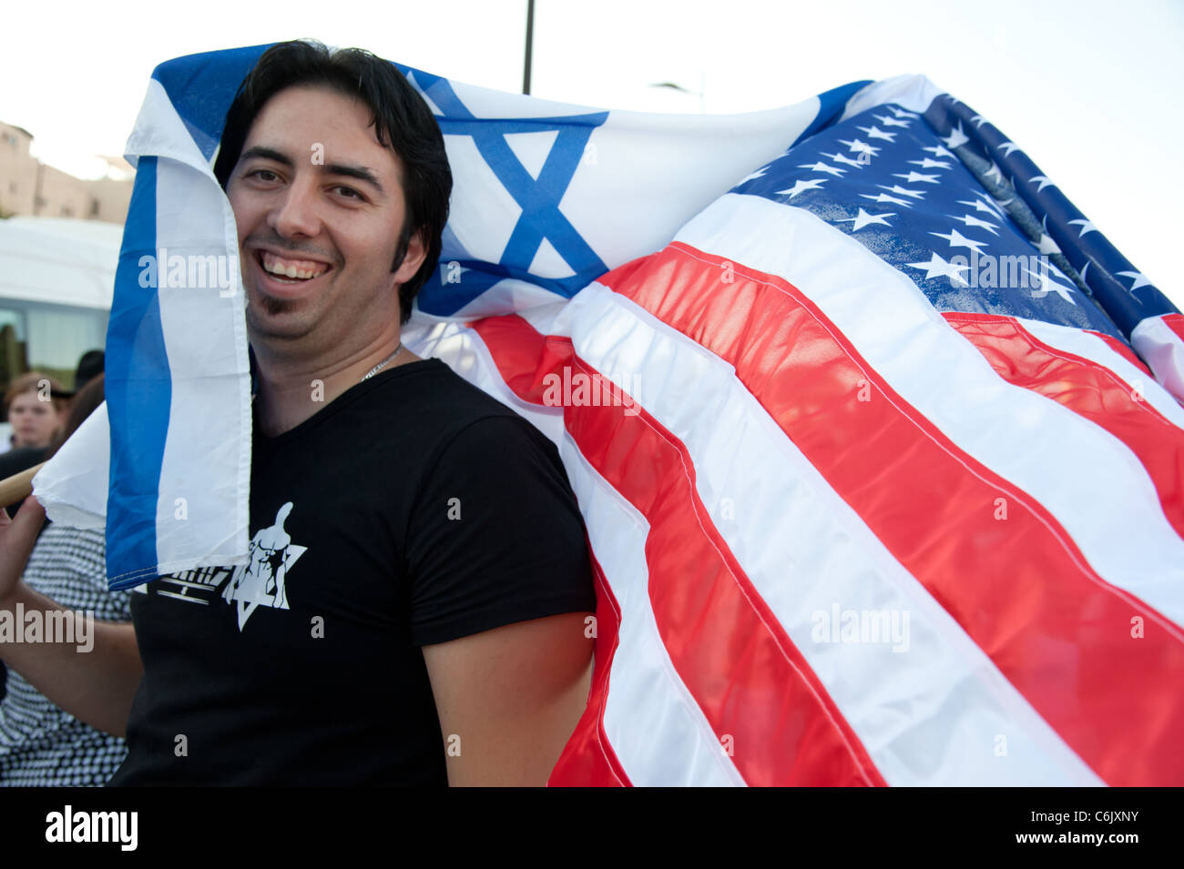 Zionists wave American and Israeli flags at a Glenn Beck rally in Jerusalem. - Stock Image