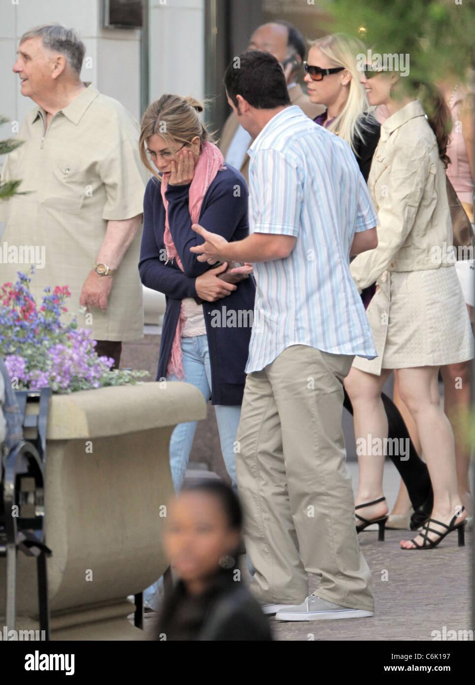 Actors Jennifer Aniston and Adam Sandler filming their new