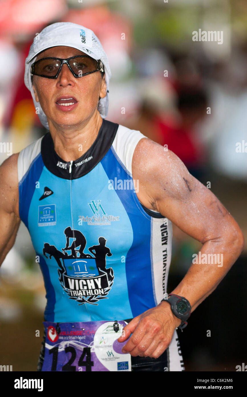 The long distance Triathlon race known as 'Challenge Vichy'. Here, the French woman triathlete : Lionéle - Stock Image