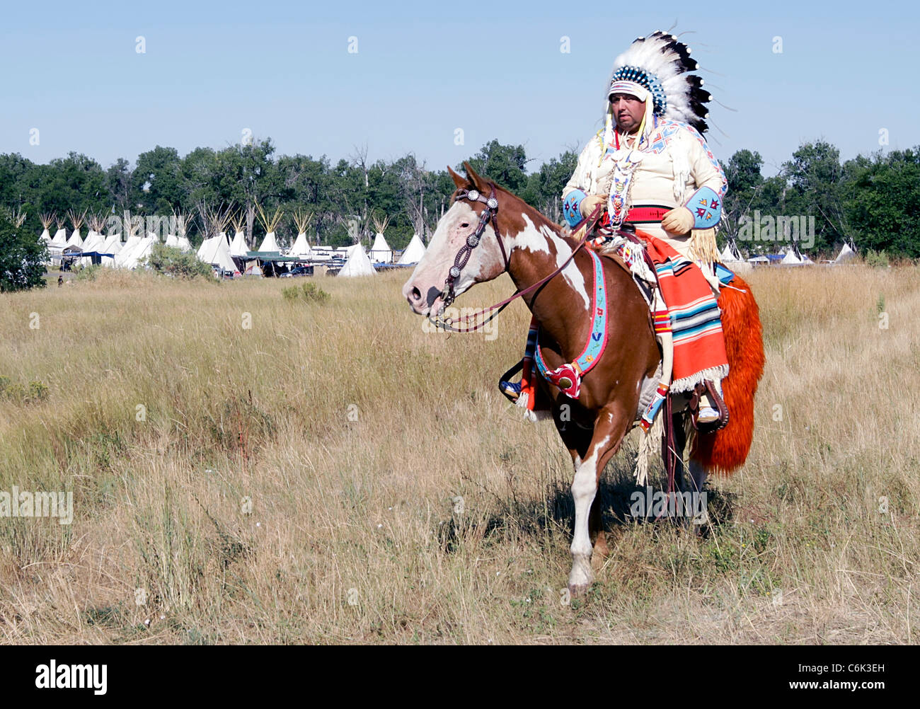 Indian chief in a parade held on the Crow Reservation, Montana, during the annual Crow Fair - Stock Image