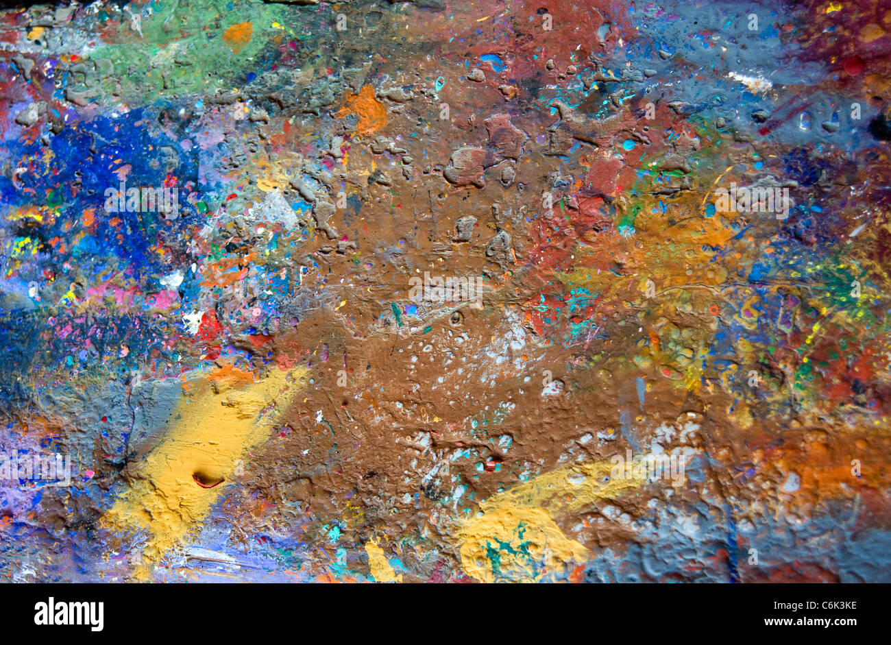 Abstract paint splatters on workshop bench at wood carving workshop in Oaxaca, Mexico - Stock Image