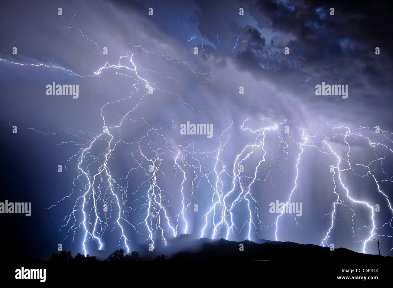 Time lapse lightning over Rincon Mountains - Stock Image