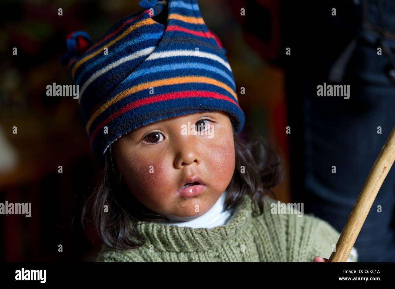 Portrait of a girl wearing a knit hat, Barrio de San Blas, Cuzco, Peru - Stock Image