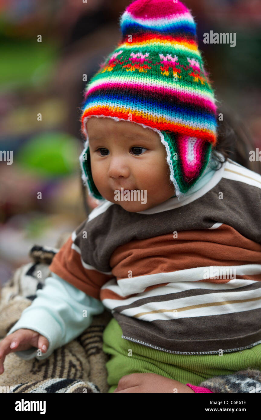 Close-up of a baby wearing a knit hat, Plaza Regocijo, Cuzco, Peru - Stock Image