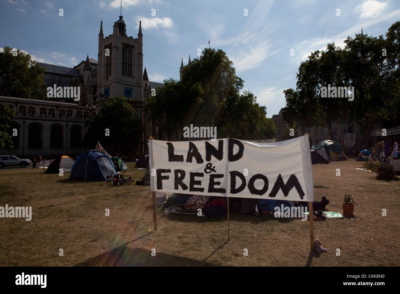 """A banner reading """"Land and Freedom"""" is seen here at Democracy Village peace camp. Stock Photo"""
