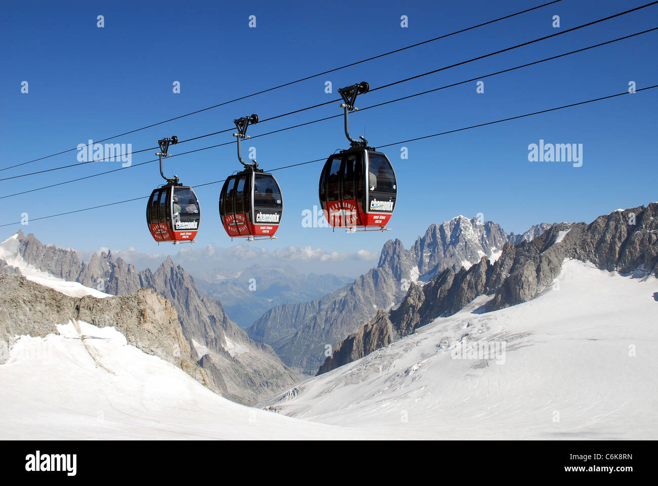cable cars cross the Mont blanc glacier on route from the Helbronner telepherique station on the way to Aiguille - Stock Image