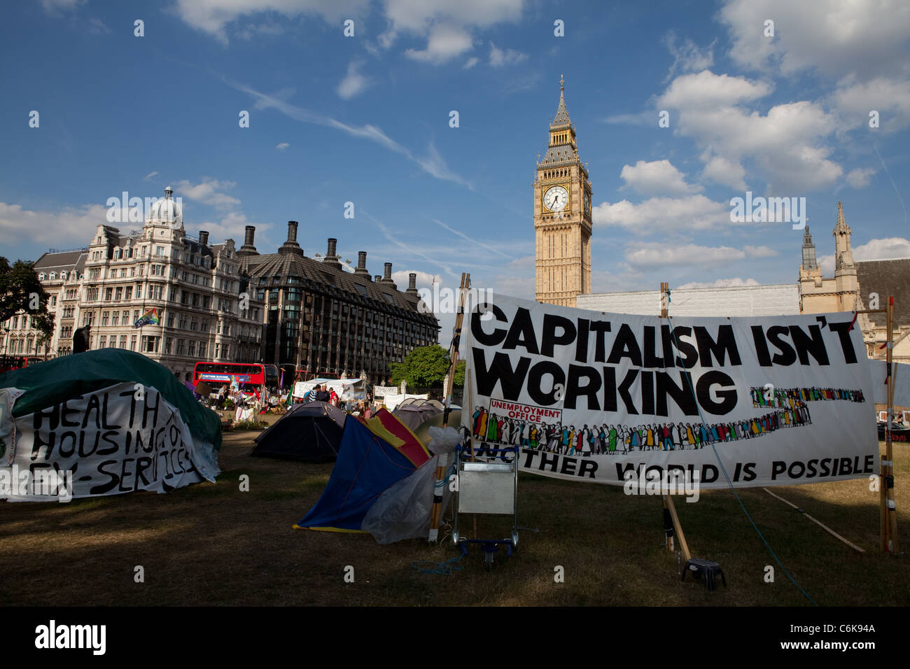 View of Democracy Village peace camp with banners, tents and Big Ben in the background. Stock Photo