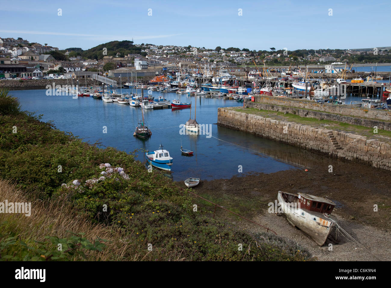 Fishing boats and pleasure craft Newlyn harbour with town in background Cornwall UK Stock Photo