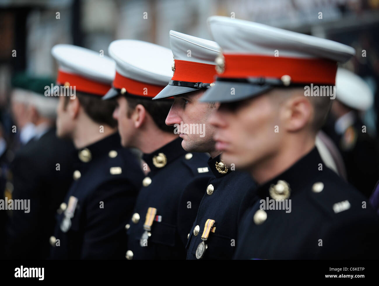 Royal Marines in dress uniform amongst mourners gathered for a repatriation ceremony at Wootton Bassett, Wiltshire - Stock Image