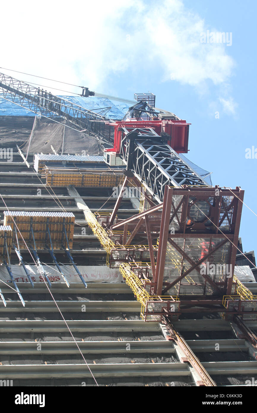 Super crane building a high rise building Stock Photo
